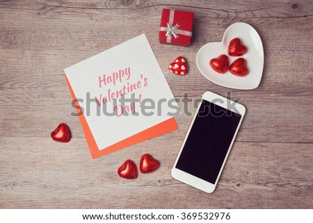 Valentine's day flat lay with note paper and smartphone. View from above - stock photo