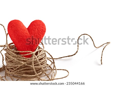 Valentine's Day. Heart Felt red Handmade in Nest with hearts made of bark. Love - stock photo