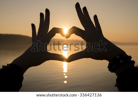Valentine's Day - Holiday-Heart shape made with hands - stock photo