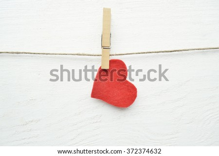 Valentine's Day.love concept, love confession.Happy valentine's day background with hearts hanging on rustic driftwood texture background,Love concept.  - stock photo