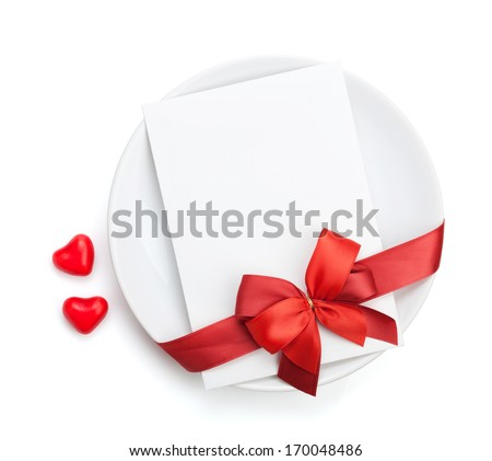 Valentine's Day love letter over plate with red bow. Isolated on white background - stock photo