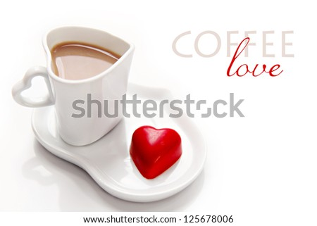 Valentine's Day morning coffee with red heart chocolate on white background - stock photo