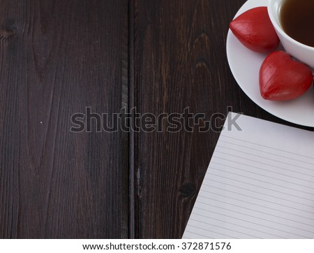 Valentine's day note with a Cup of coffee and dessert. A date in a vintage café. Wooden heart on a plate. - stock photo