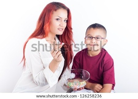 Valentine's day Pretty young mom and her son with a bowl of heart shaped candies