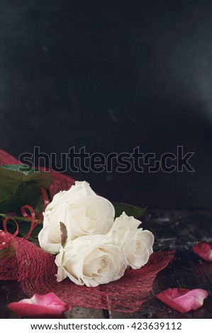 Valentine's day roses and champagne over dark background .Toned photo - stock photo