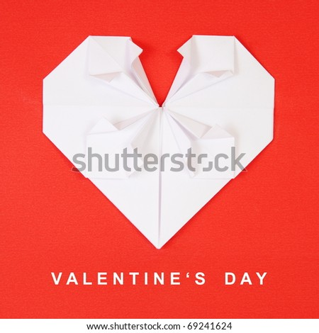 Valentine's Day White Heart on Red Paper Origami Card - stock photo