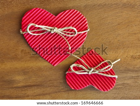 Valentine's paper hearts with bow on wood