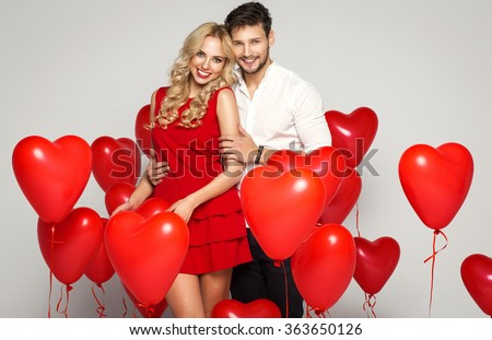 Valentine's photo of young loving couple with balloons heart - stock photo