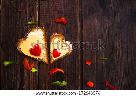 Valentine sandwiches for breakfast for lovers on wooden background - stock photo
