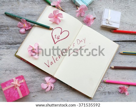 valentine text hand writing on notebook page with heart shape concept and idea for valentine  - stock photo