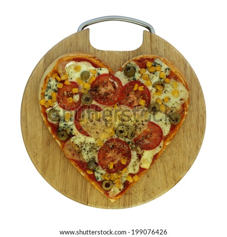 Valentine vegetarian pizza - pizza in the shape of heart - stock photo