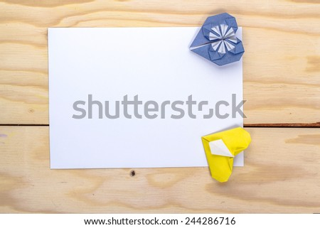 valentines card with origami blue and red hearts on wooden table  - stock photo