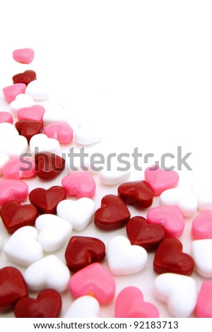 Valentines Day background or corner border of red, pink and white candies - stock photo