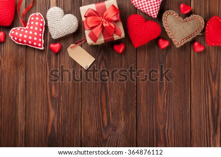 Valentines day background with handmaded hearts and candies over wood. Top view with copy space - stock photo