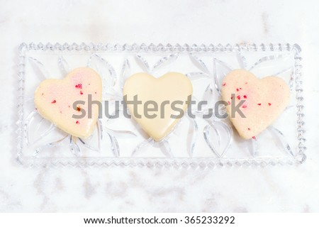 Valentines Day background with heart and roses. Vintage style. Heart shaped cookies for valentine's day Mother day