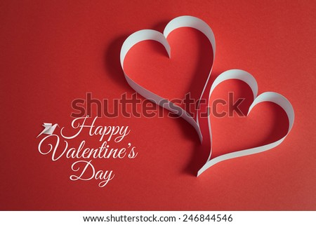 valentines day background with origami bird and paper cut hearts.