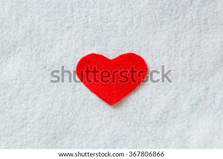 Valentines Day background with red heart on white fabric texture