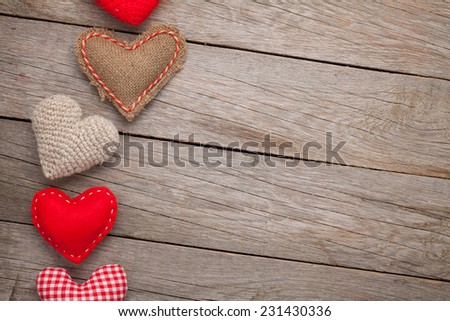 Valentines day background with toy hearts and copy space - stock photo