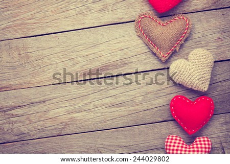 Valentines day background with toy hearts and copy space. Toned - stock photo