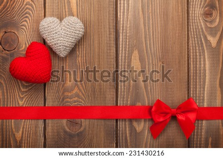 Valentines day background with toy hearts, red ribbon and copy space - stock photo