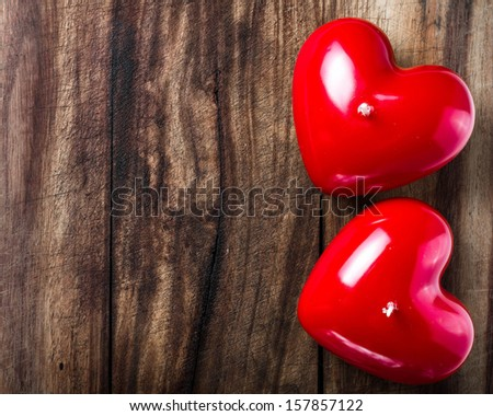 Valentines Day background with two Red Hearts on old vintage wooden background with copyspace for text. Love and Valentines day concept. - stock photo
