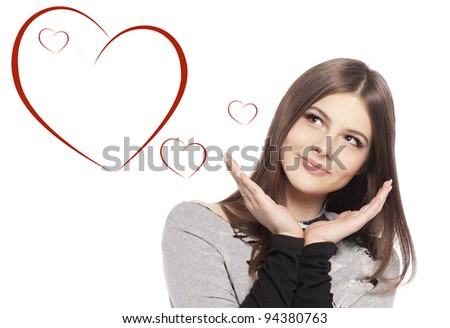 Valentines Day. Beautiful girl teenager with Valentines Day heart sign glossy hair with copy space closeup in studio on white background - stock photo