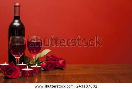 Valentines day: bottle of vine, glasses, red roses and candles  romantic time  - stock photo