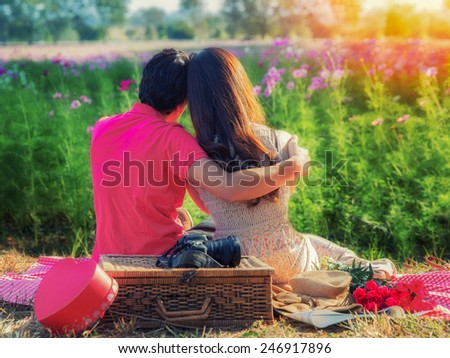 Valentines day concept, Young couple in love, Attractive man and woman enjoying romantic date at the garden sunset - stock photo