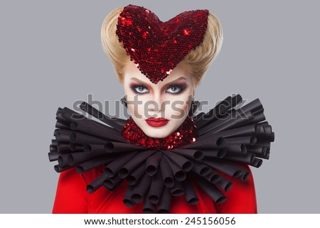 Valentines day. Creative portrait of a beautiful young girl with fashion makeup, and hair in the shape of a heart - stock photo
