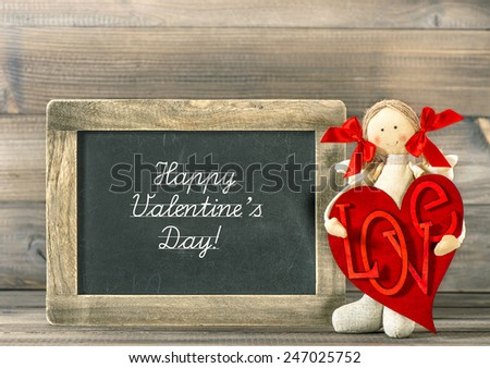 Valentines Day decoration. Funny girl with Red Heart and blackboard. Sample text Happy Valentine's Day! - stock photo