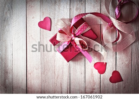 Valentines Day gift,hearts and greeting card on wooden plates in vintage style - stock photo