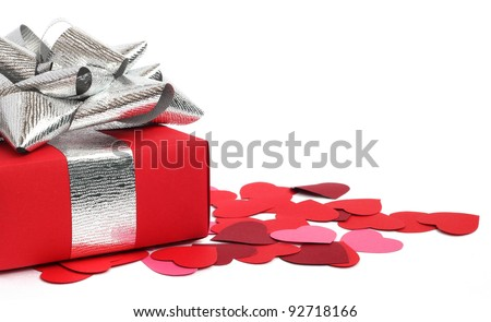 Valentines Day gift in red box and small hearts isolated on white - stock photo