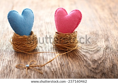 Valentines Day. Handmade Hearts Couple in nest. Retro. Love concept on wooden background - stock photo