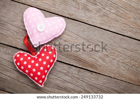 Valentines day handmaded toy hearts over wooden table with copy space - stock photo