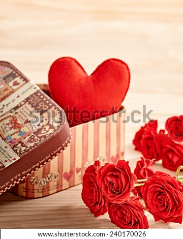 Valentines Day. Heart Handmade in gift box and Red Roses, Vintage. Retro Styled. Love concept on wooden background - stock photo