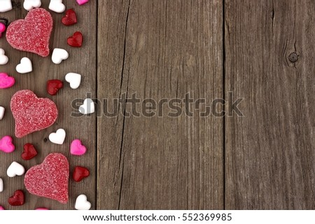 Valentines Day Heart Shaped Candy Side Border On A Rustic Wood Background
