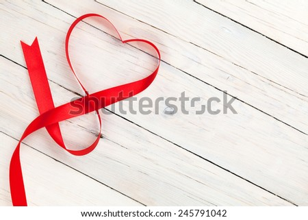 Valentines day heart shaped ribbon over white wooden table background with copy space - stock photo