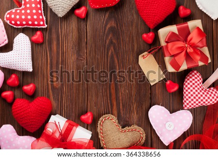 Valentines day hearts and gift boxes over wooden background. Top view with copy space - stock photo