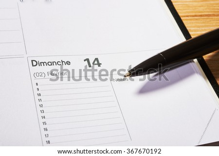 Valentines day in agenda with black pencil - stock photo