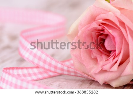 Valentines day in romance with rose and heart as symbol for love - stock photo