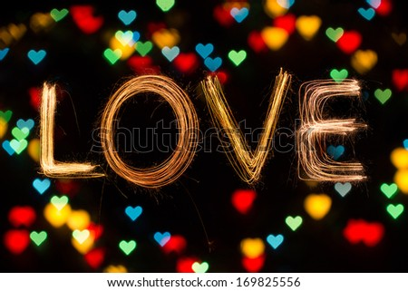 Valentines Day -  Love sparkler firework light alphabet with bokeh light - stock photo