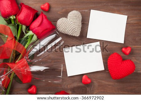 Valentines day photo frames, champagne and red roses on wooden table. Top view with copy space - stock photo