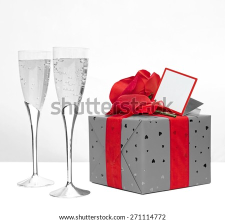Valentines day present and champagne - stock photo