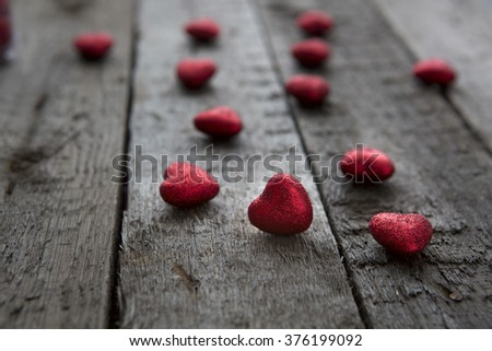 Valentines day red heart on wood background. Hearts hanging on white painted wooden background