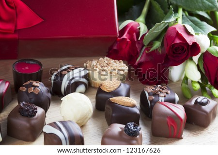 Valentines day roses and chocolates. - stock photo