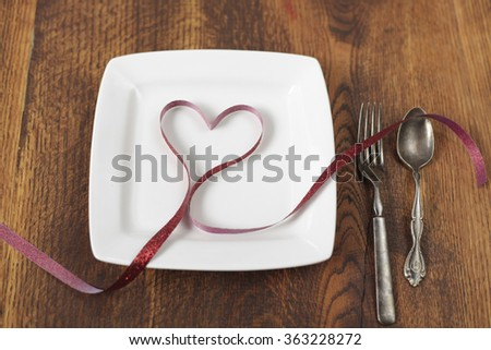 Valentines day table setting with red heart ribbon - stock photo
