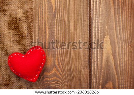 Valentines day toy heart over wooden table background with copy space - stock photo