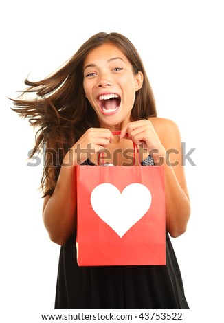 Valentines day woman very happy and excited for her gift / present. Beautiful mixed race asian / caucasian model isolated on white background. - stock photo
