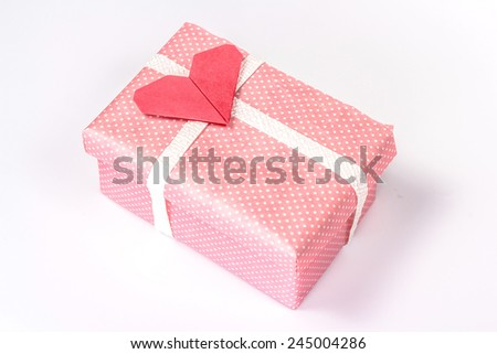 valentines gift box with red paper heart - stock photo