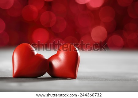 Valentines heart on red bokeh background - stock photo